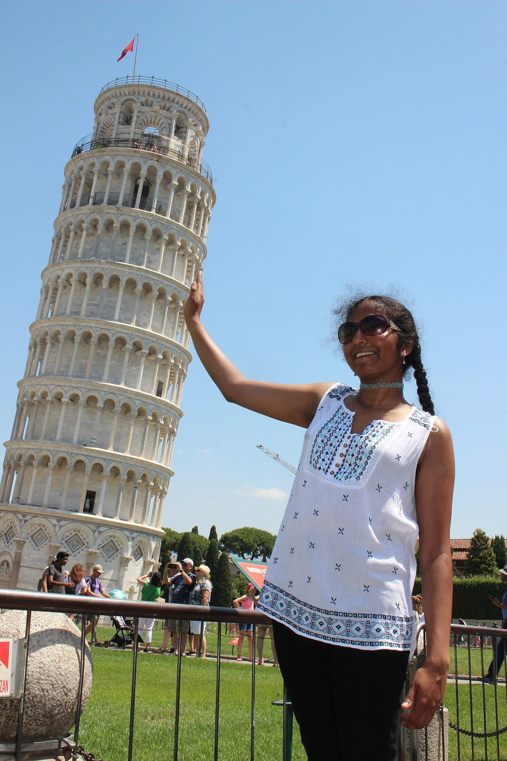 A picture of me holding the Leaning Tower of Pisa
