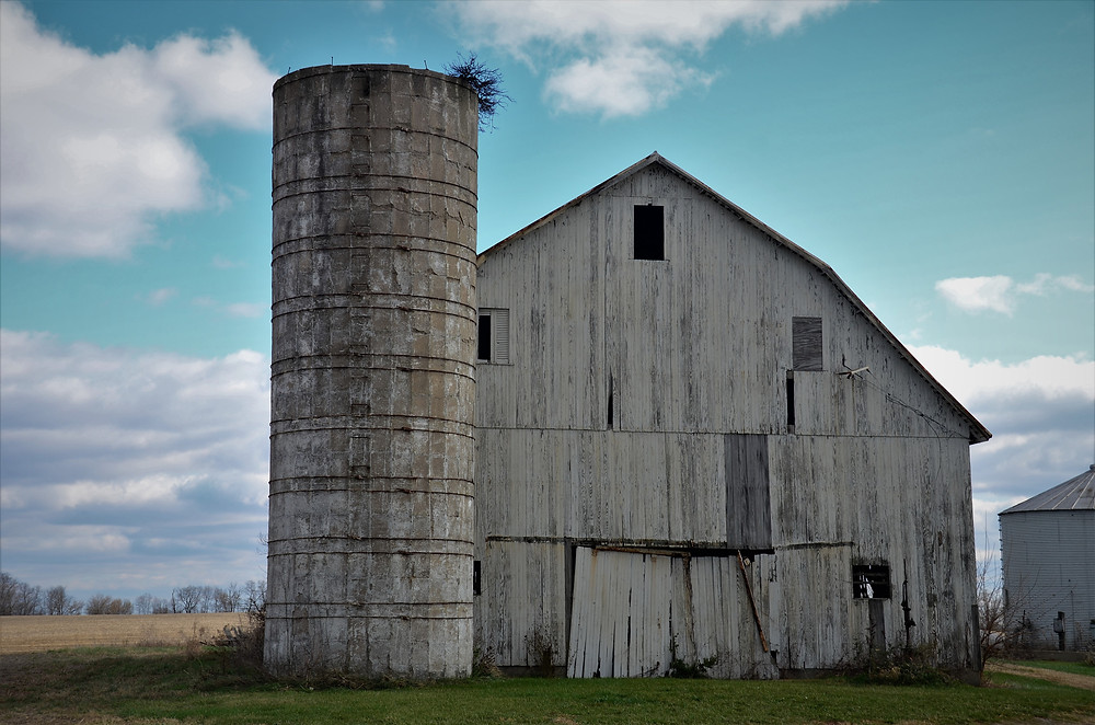 An old barn that is falling apart and should be removed from the property