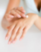 Canva - Woman Applying Lotion on Hand.jp