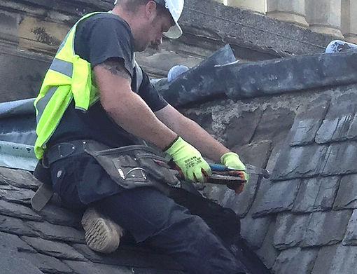 Falcon roofing slater at work