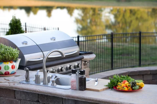 Outdorr grill overlooking a backyard
