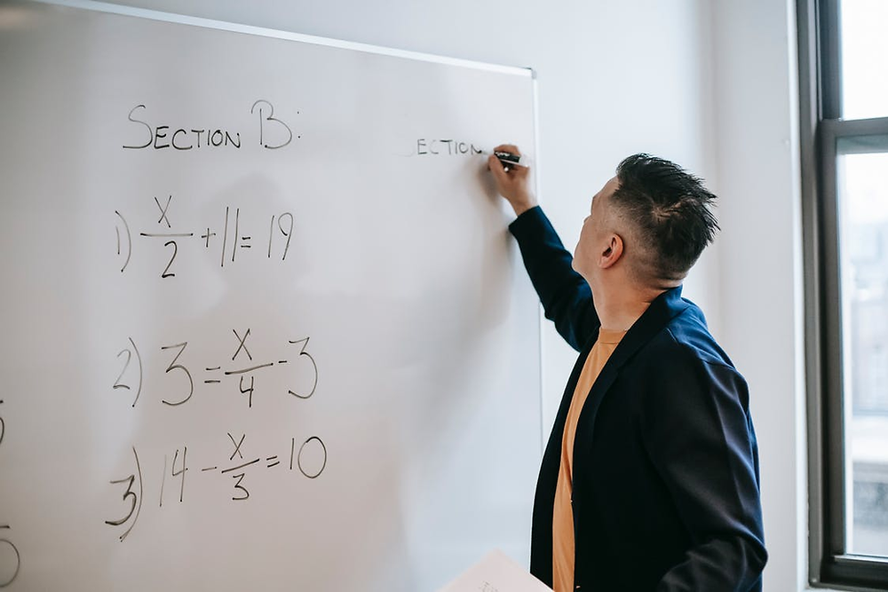 Solving math problems on a whiteboard