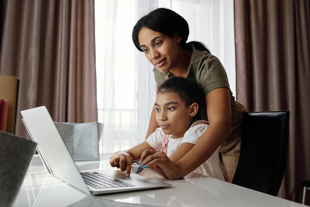 A child attending an online class at home