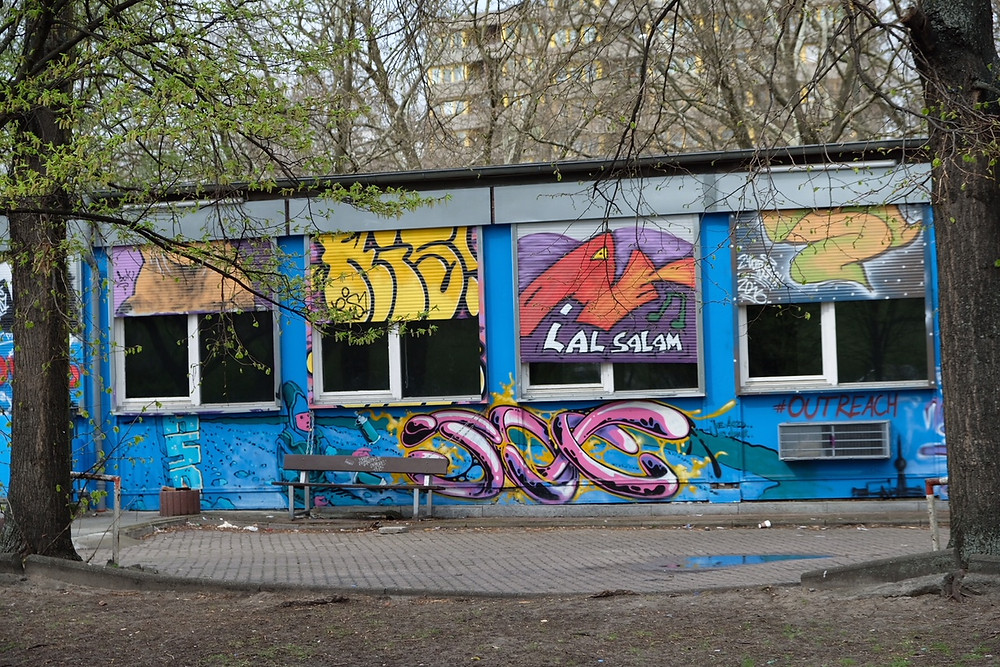 A colour picture of a gritty city.  Berlin offers culture, colour, history and community.