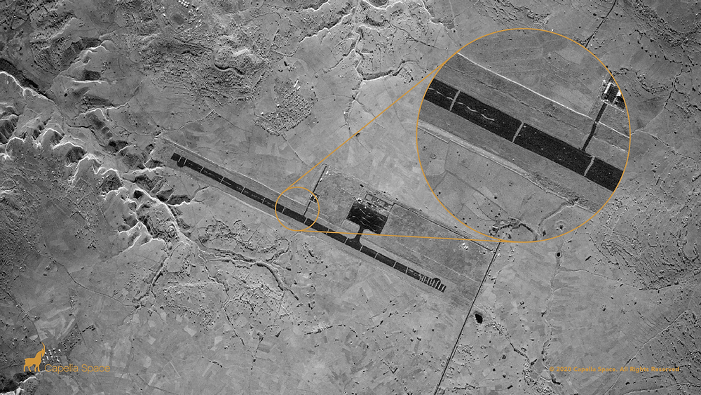 This SAR image of the Axum Airport shows 23 trenches dug perpendicularly across the runway to prevent its usage during the Ethiopian Tigray conflict. A zoomed in view displays the individual trenches in contrast to the dark tarmac as well as debris cluttering the runway's surface. The airport was recaptured by Ethiopian government forces from the TPLF who were accused of sabotaging the airfield before losing control to federal forces.
