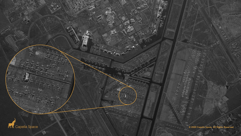 """This image of the Roswell International Air Center shows the airport along with a """"boneyard"""" where American Airlines retires its McDonnell Douglas MD-80 aircraft and Airbus A300-600R jetliners. The aircraft and shadows reveal granular details such as the size of a fuselage, cockpit, wings, and engines."""