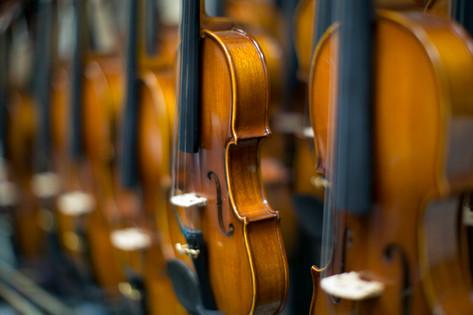 Violins waiting for bows