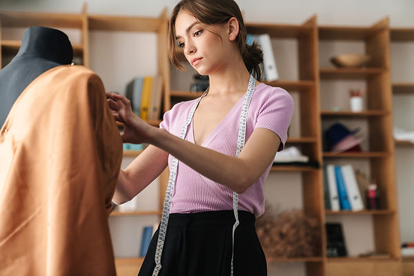 concentrated-young-woman-designer-PB6P7E