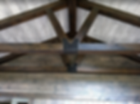 Etchwood on a wall, ceiling, and beams