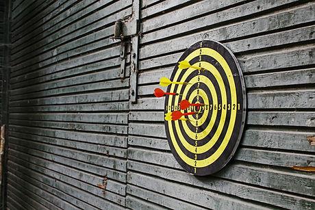 Darts in dartboard on wall