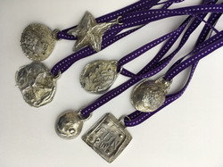 Cast pewter medals created by pupils