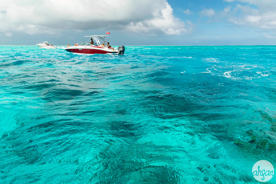 Boating over the turquoise waters and coral reefs of the Bora Bora Lagoon in French Polynesia.  Price List #1