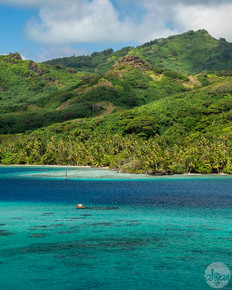 Sailing past the blue waters that surround Huahine, French Polynesia.  Price List #1