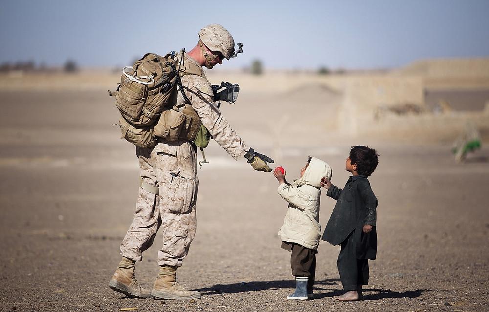 soldier interacting with children