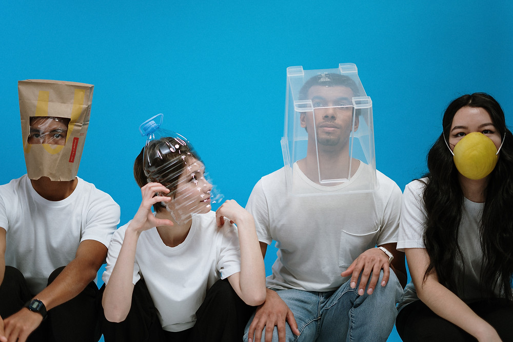 people with containers over their heads and mask