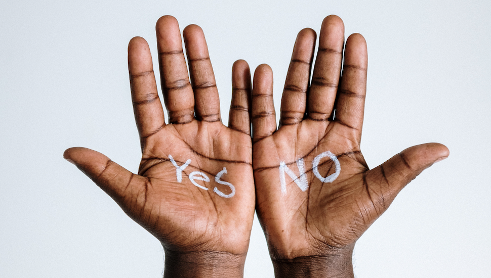 open palms inscribed with the words yes and no