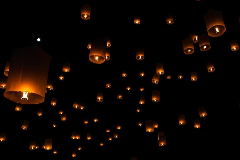 night sky full of wish lamps