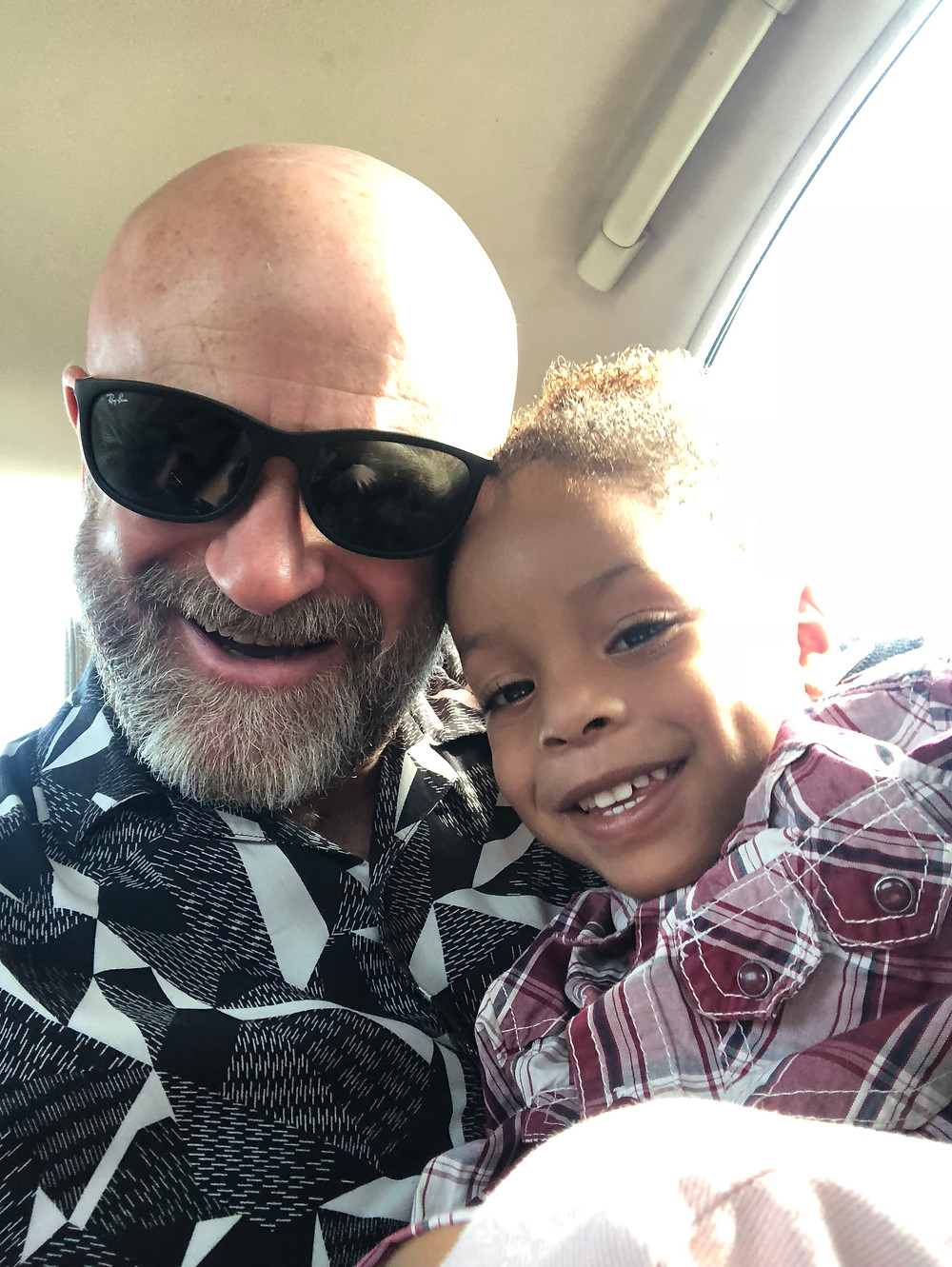 life coach Eddy Smits next to smiling child