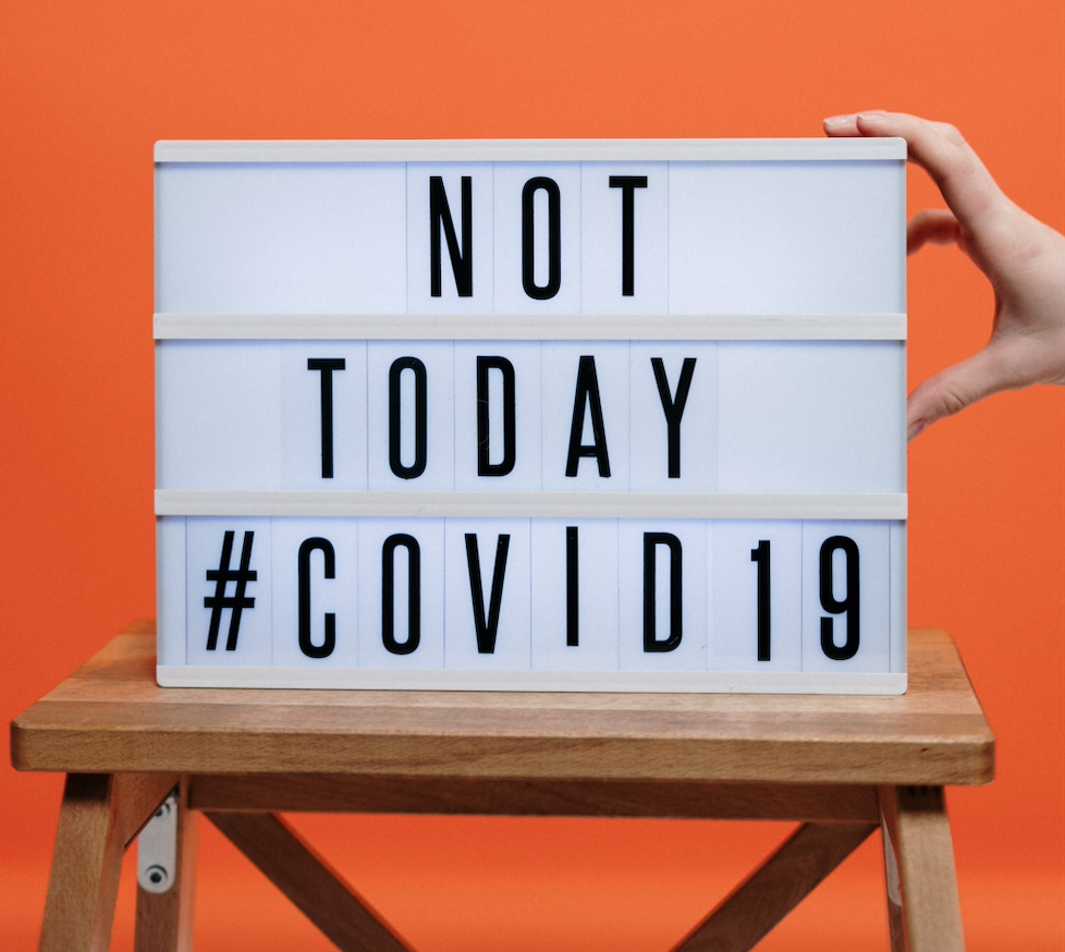 board with text not today covid
