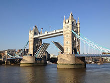 London's historic Tower Bridge opening for a ship to pass under , it is near the Tower of London