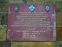 new college Anniversary plaque.