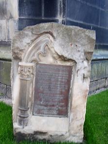 Stone with plaque bide Scott Monument Edinburgh