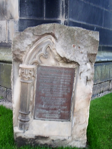 Stone with plaque bide Scott Monument Edinburgh