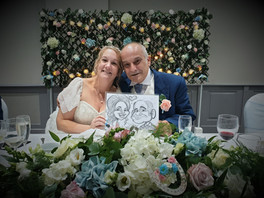 bride and groom caricature at wedding