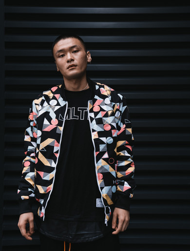 Hollywood Hamilton Clothing model wearing an Abstract Bomber Jacket