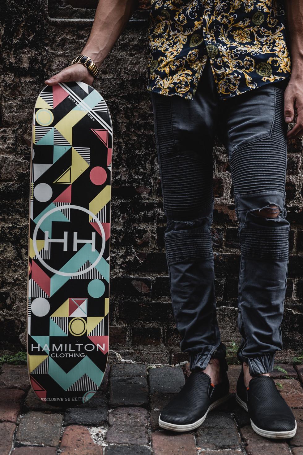 geometric skateboard deck in back alley