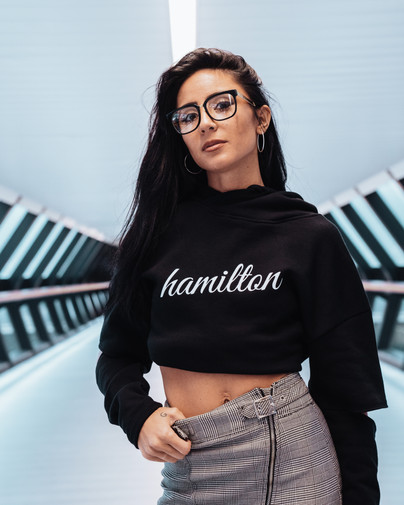 Hollywood Hamilton clothing womens model wearing a skirt and black cropped hoodie
