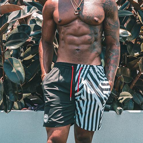 Model wearing Hollywood Hamilton zig-zag swim trunks front view