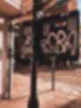 Hollywood Hamilton clothing zig zag sticker bomb in shorditch london street art
