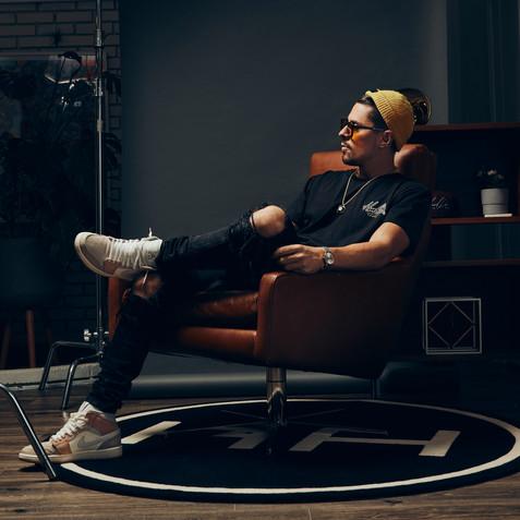 Male wearing yellow beanie sitting in chair hollywood hamilton headwear