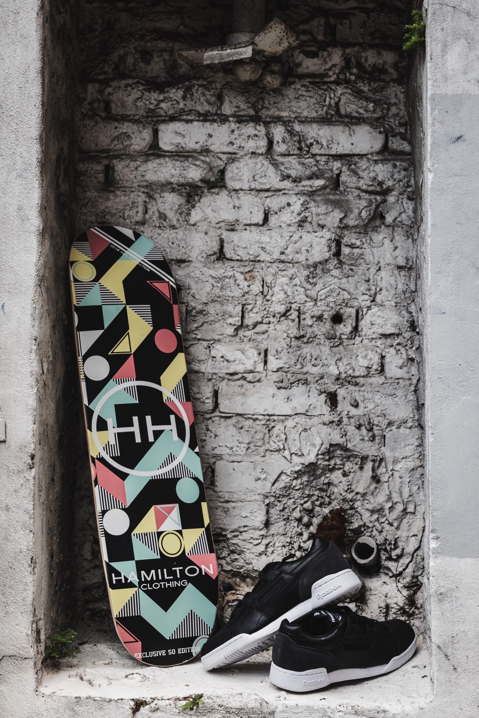 Geometric skateboard deck paired with Puma sneakers