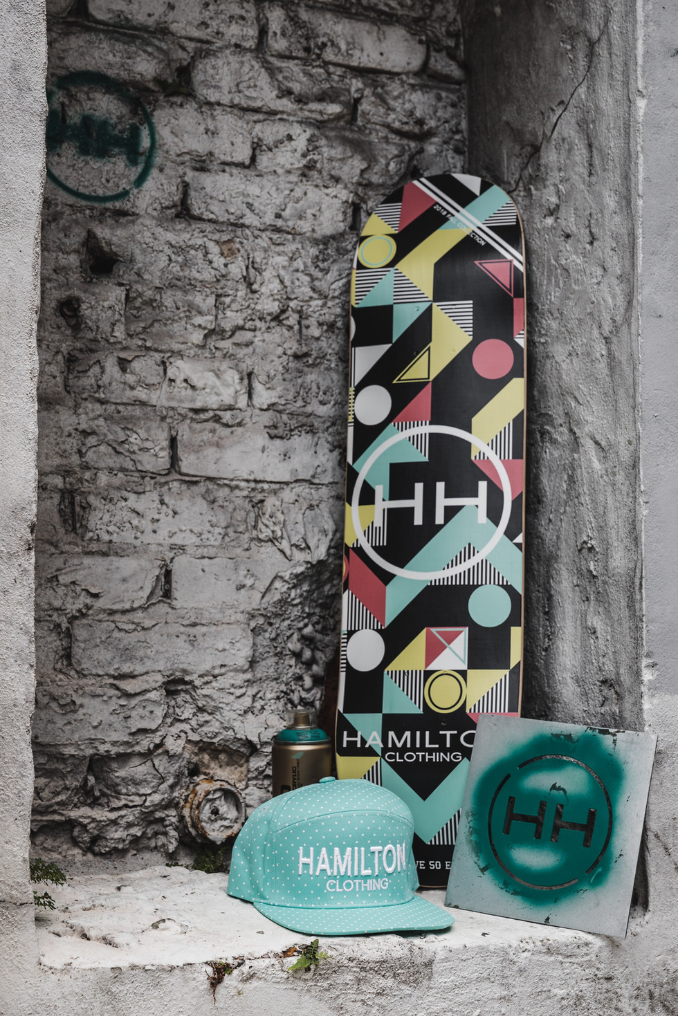 Geometric deck skateboard deck paired with teal hamilton polka hat