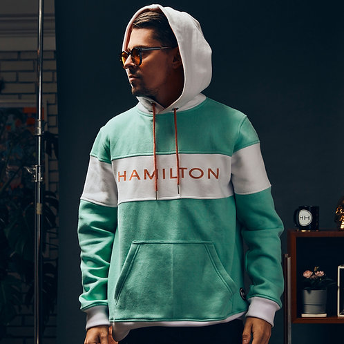 Model Wearing Hollywood Hamilton Mint Block hoodie with hood up