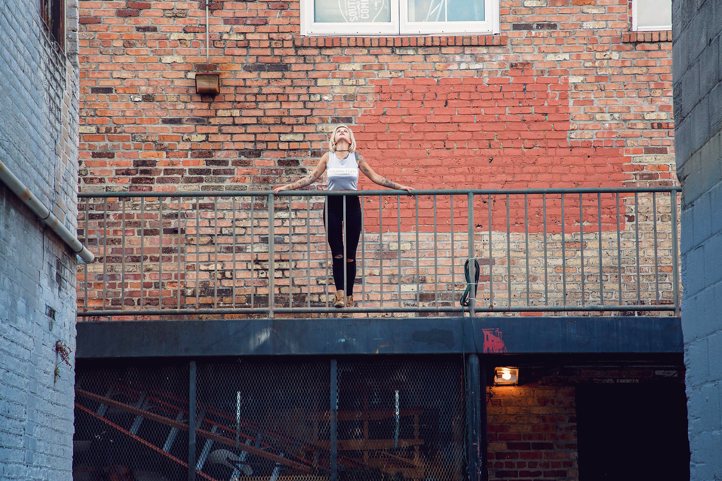Women's spring collection main header image of girl on stairs