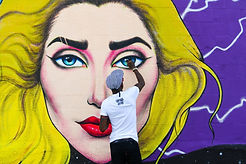 Cam parker paints lady gaga mural in hollywood hamilton prisoner hat tama artist