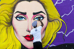 Cam parker paints lady gaga mural in hollywood hamilton prisoner hat tama artist