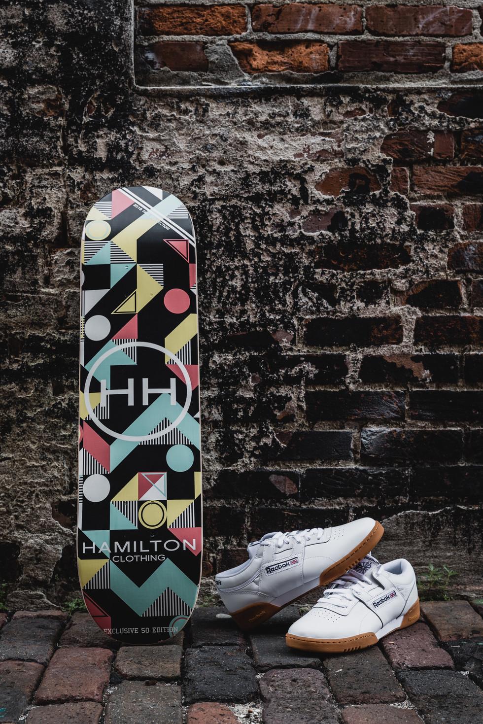 Geometric skateboard deck with white reebok originals.