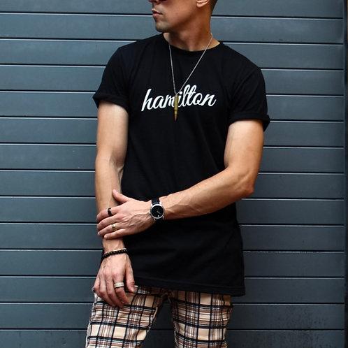 model wearing hamilton cursive rolled cuff tee white logo