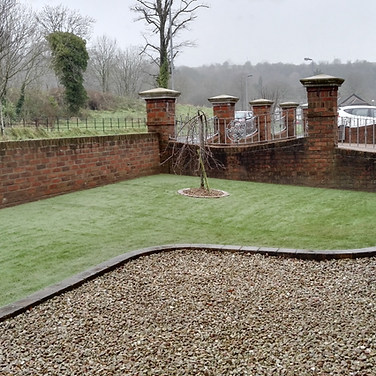 30 mm pile artificial grass for that year long green lawn. Maintenance free gravel driveway.