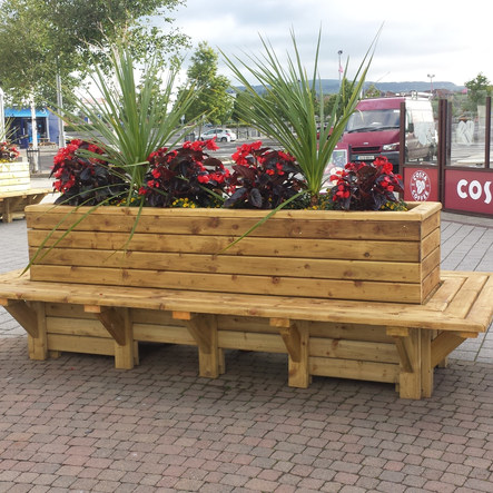 Purpose-built planter with seating on all sides for busy public area.