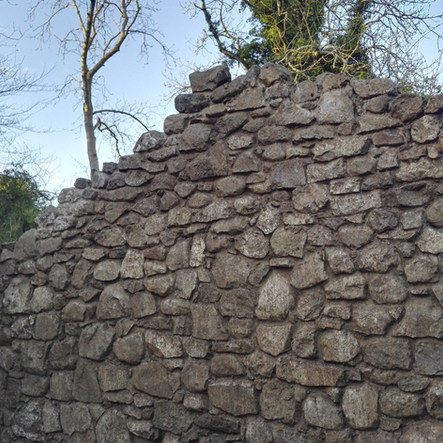 Old stone building rebuilt from the ground up using all the existing stones that had fallen over the years.