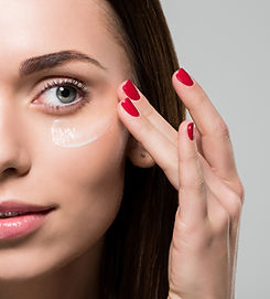 A woman putting on moisturizer after Botox treatment from Age-Less Weigh-Less in Dover, NH
