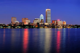 Boston city skyline at dusk with Prudent