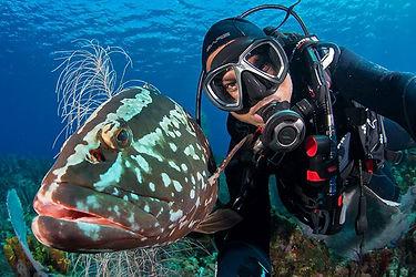 Solomon Baksh with Nassau Grouper in The Cayman Islands