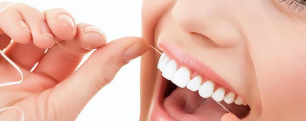 Usar fio dental adequadamente