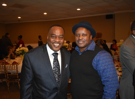 Project Longevity Bridgeport's Harold Dimbo receives Community Impact Award.